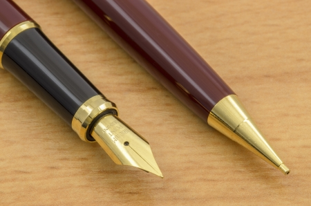 fine tip: Fountain Pen and Pencil Set Close-Up on a Wooden Desk.