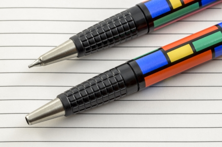 fine tip: A Close-Up of a Colourful Pen and Pencil Set on White Lined Paper.