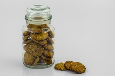 A Cookie Jar filled with Homemade Honey and Oatmeal Cookies with White Copyspace. photo