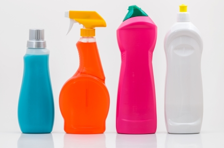 A Group of Blank Colourful Household Cleaning Bottles on White. photo