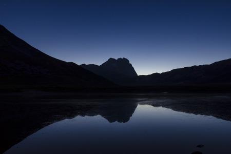 abruzzo: The reflect of the Gran Sasso on the Pietranzoni lake, Italy