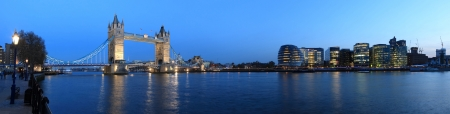 Tower Bridge and the Thames panoramic view about London at night photo