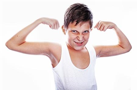 Portrait of little european boy flexing biceps  Isolated on white background photo
