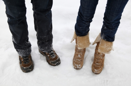 Two people wearing boots in winter outdoor photo