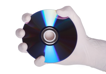 This is an image of a hand holding a cd, metaphor for data protection Stock Photo - 14978984