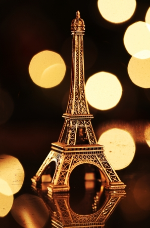 Miniature Eiffel-tower with defocused spot lights in background photo