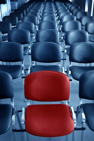 one on one meeting: Empty conference room with one red chair
