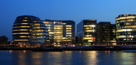 Modern office buildings in London at evening