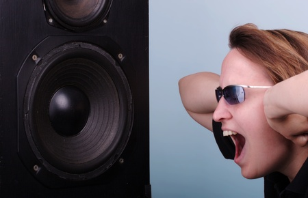 going crazy: Young woman going crazy about loud music Stock Photo