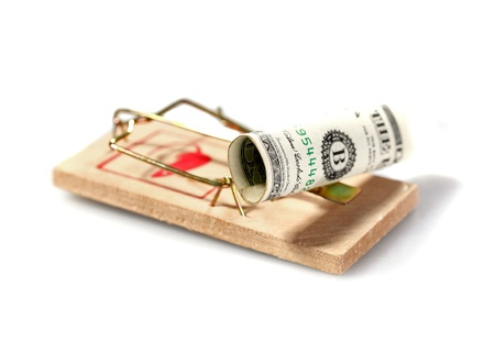 Money on mouse trap isolated on white