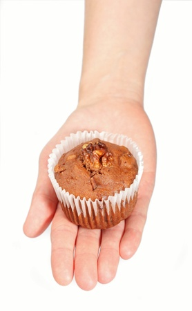 Hand holding a muffin isolated on white photo