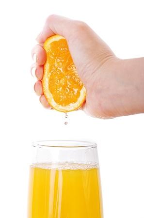 Fresh squeezed orange juice isolated on white Imagens