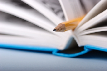 Yellow pencil in book sharpness on pencil Foto de archivo