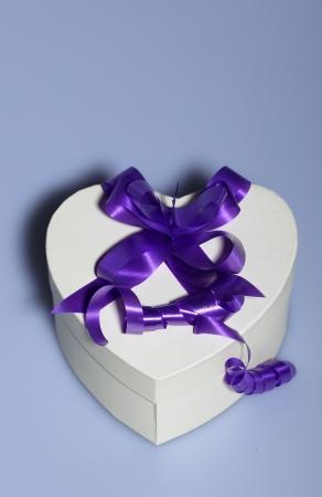 Heart shaped present box with ribbon photo