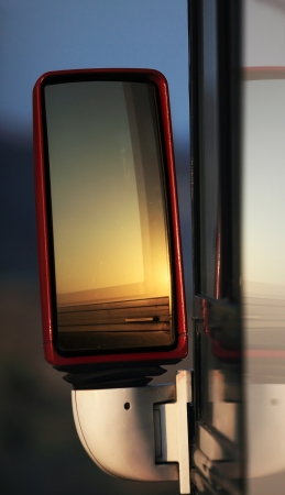 Reflective rearview mirror of bus photo