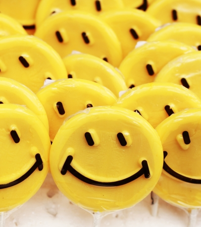 Smiley emotions on yellow lollipops photo
