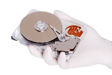Computer hard disk holds a white gloved hand Stock Photo - 14979504