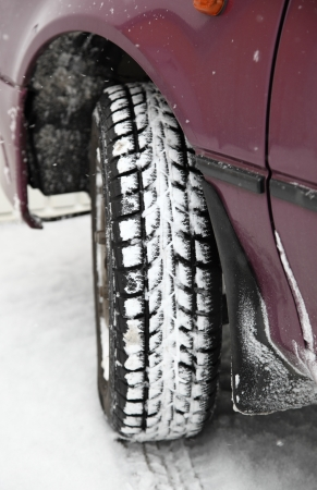 Winter tyre of lilac car photo