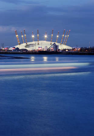 Huge tent at the bankside of the blue Thames in London at evening photo