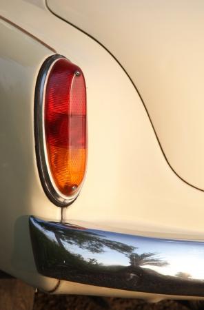 rear end: Rear red lights on plain beige car