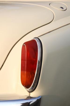stoplights: Rear red lights on plain beige car