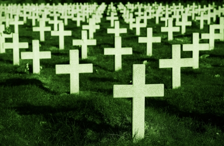 christian halloween: Crosses in cemetery with green grass Stock Photo