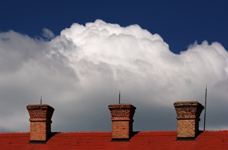 Bricked chimney with nice cloudy sky photo