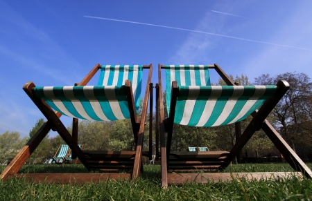 Stripped deckchairs in Hyde-park London Stock Photo