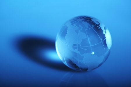 Translucent globe with blue background Stock Photo
