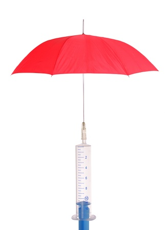 The concept of vaccination against the infection with injection and red umbrella photo