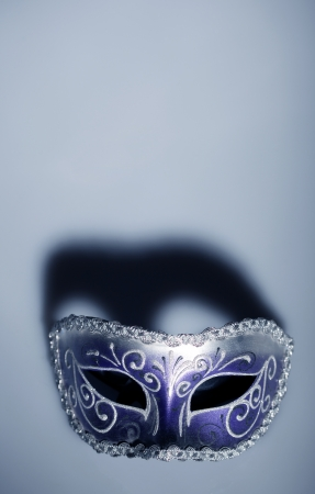 Carnival mask with shadow in blue color photo