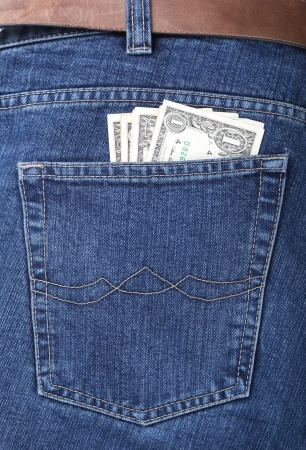 Lot of dollars in a pocket of jeans photo