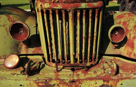 The front of an old rusty car photo