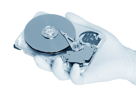 Computer hard disk holds a white gloved hand Stock Photo - 14977776