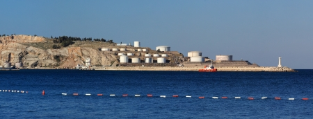 Panorama view of sea with oil tanks photo