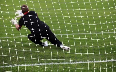 blocking: Soccer football goalkeeper making diving save