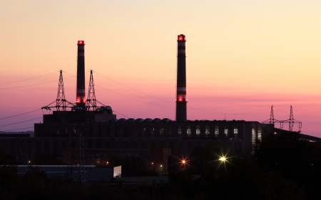 Power station with chimney at evening photo
