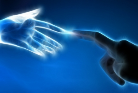 Human hand and artificial hand touch each other photo