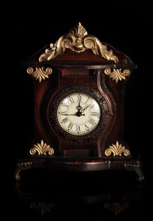 timekeeper: Vintage clock with black background Stock Photo