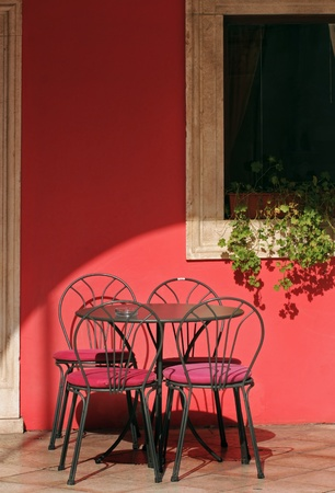 caf: Terrace of red wall restaurant in the morning