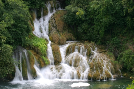 Beautiful waterfall with green vegetation in Croatia photo