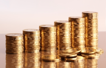 money exchange: Six coin piles with reflection Stock Photo