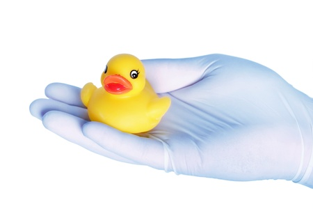 Holding toy duck with gloved hand Stock Photo - 15391858