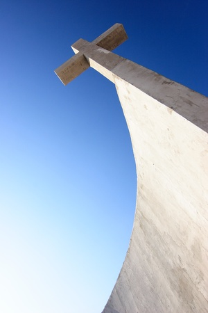 godly: Concrete crucifix with nice blue sky