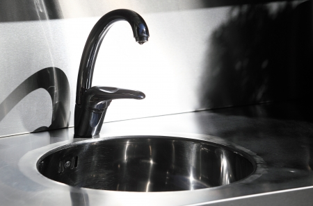 rustproof: Stainless steel sink in a kitchen Stock Photo