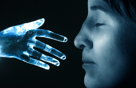 Artificial robot hand touches the nose of a woman photo