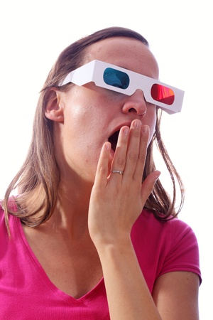 Young woman wearing 3d-glasses and yawning Stock Photo