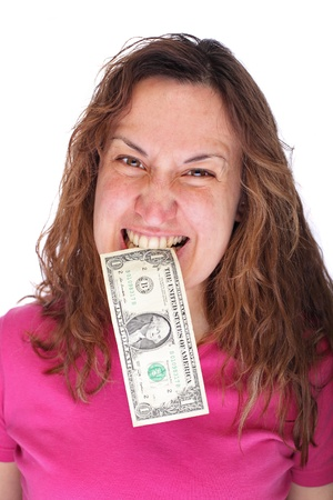 Young woman biting dollars by his teeth photo