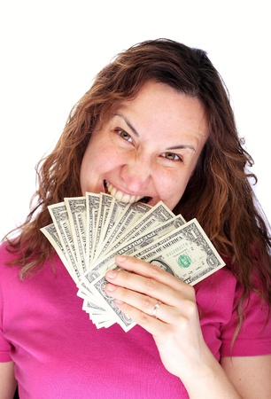 Aggressive young woman holding banknote in mouth photo