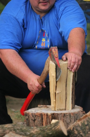 cleave: Fat man is chopping wood Stock Photo